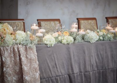 tables-with-flowers-decorations-ballroom-hall