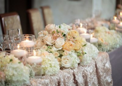 table-with-candles-and-flowers